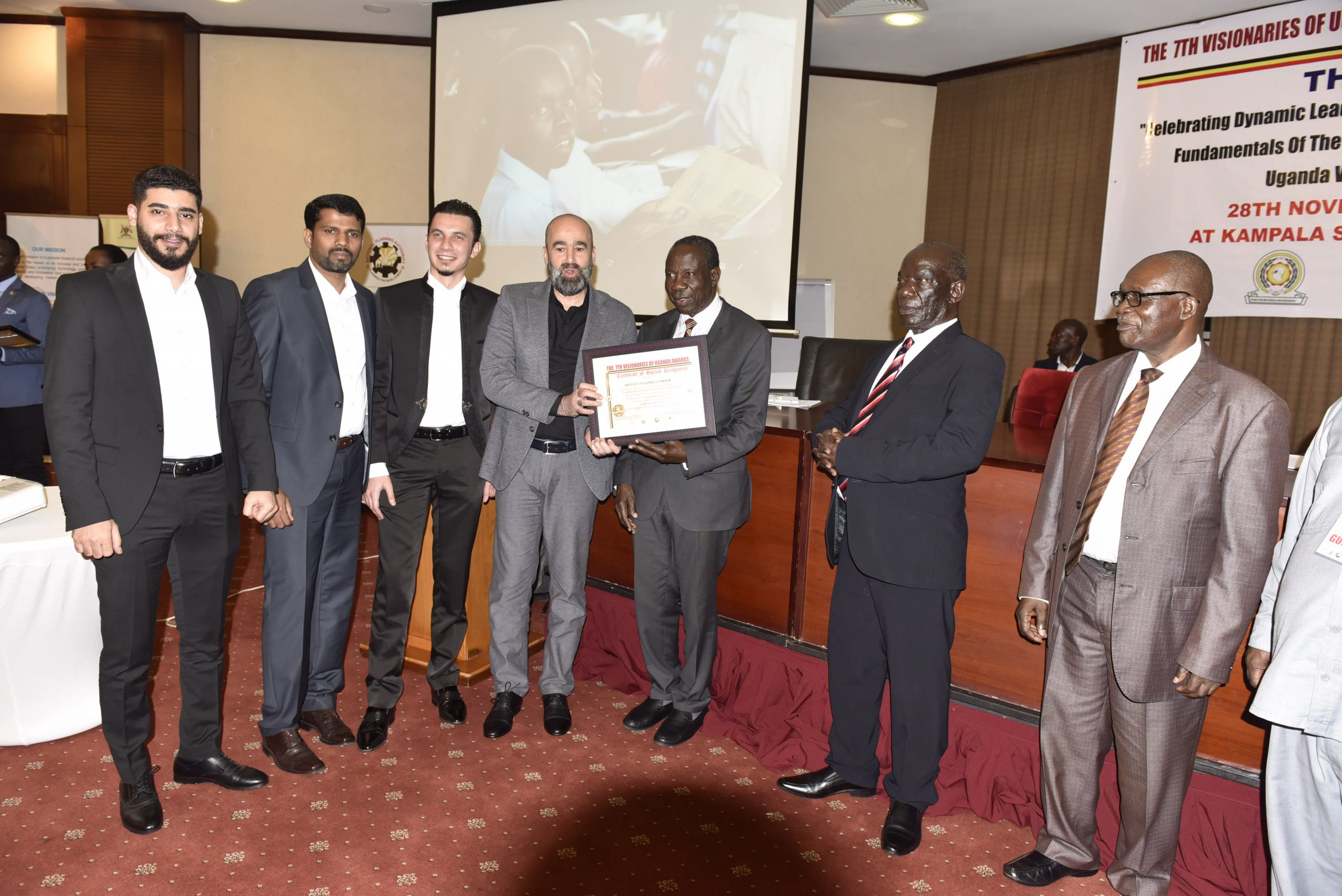 Managing Director , Biplous Uganda Limited and the team receiving the Visionary Award as the Best Furniture Supplies Company of the Year